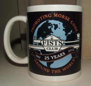 Photograph of the FISTS 25th Anniversary Mug with the full size black version of the anniversary logo