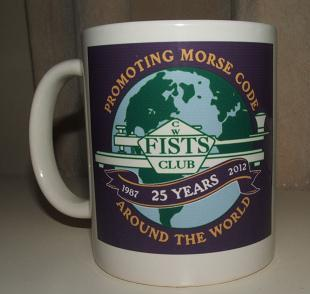 Photograph of the FISTS 25th Anniversary Mug with the full size lilac version of the anniversary logo