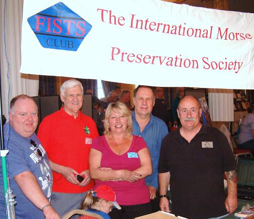 Photograph of Paul M0BMN, Roy G4SSH, Gillian M0BTG, Terry G0PIL and John M0CDL at the FISTS stand, NARSA Norbreck Rally in April 2011