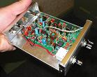 Small photograph of SW-80+ QRP CW transceiver in its case.  Click for a large image