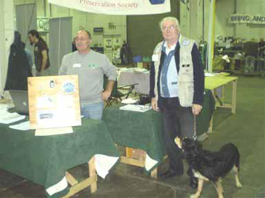 Photograph of Donnington 2008 FISTS stand showing John M0CDL, Derrick M0BDD and Derrick's dog Peggy.