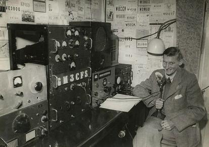 Photograph of Jim GM3CFS in his shack.